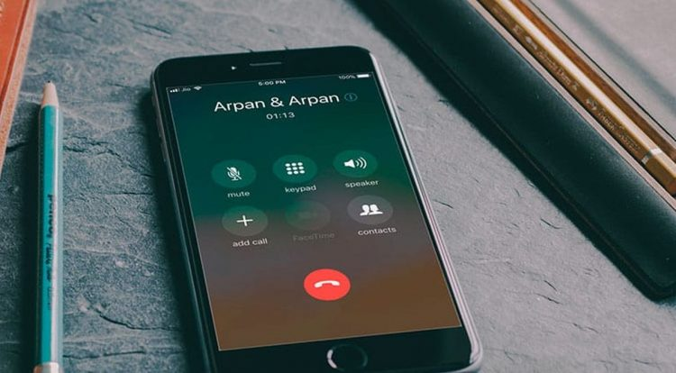 How to make a conference call with more than two people on your iPhone?